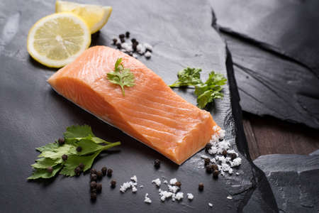 rosmarin: Fresh salmon with spices, cooking concept.
