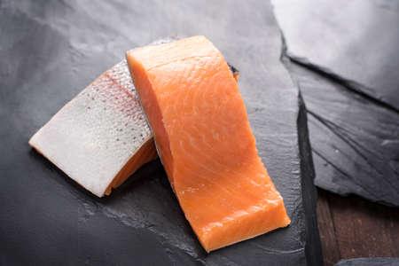 rosmarin: Fresh salmon  fillet on black background.
