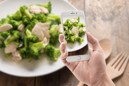 stir fried: Taking photo of broccoli Fried in wooden background. Stock Photo