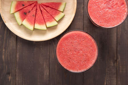 sliced watermelon: Healthy watermelon smoothie on a wood background