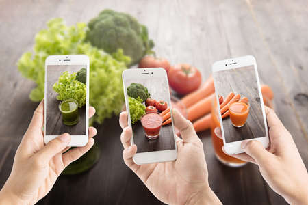 overhead shot: Taking photo of vegetable Juices with fresh ingredients