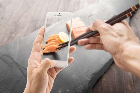 taking photo: Taking photo of fresh salmon with lemon on black background