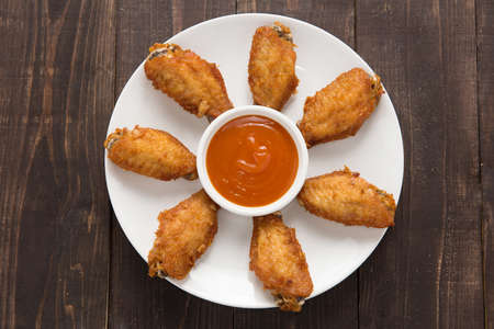 fried chicken wings: Top view fried chicken wings on wooden background. Stock Photo