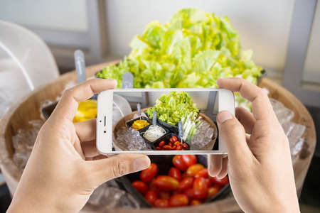 overhead shot: Taking photo of salad bar with vegetables in the restaurant Stock Photo