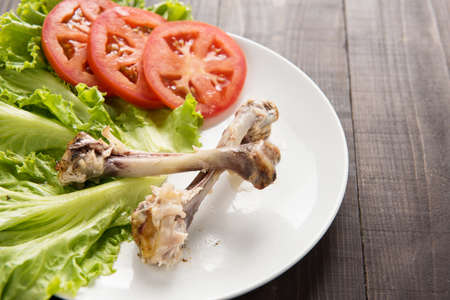 wildfowl: Bone chicken and vegetable on wooden background Stock Photo