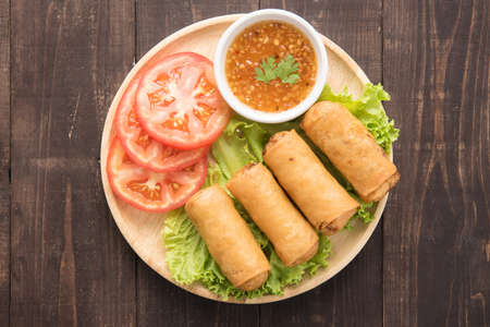 Fried Chinese traditional spring rolls on wooden background Archivio Fotografico