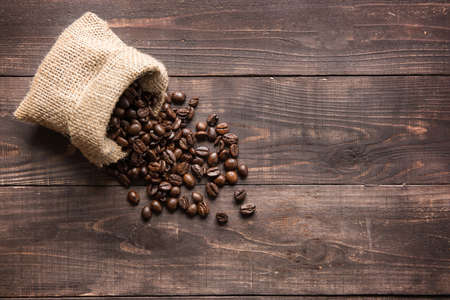 coffee beans on wooden background and empty space Stockfoto