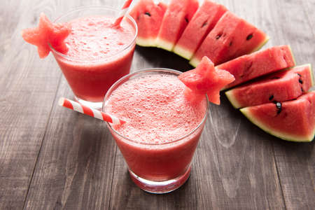 Healthy watermelon smoothie with of watermelon in star shape on a wood background
