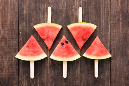 sliced watermelon: Fruit ice cream sliced watermelon on wooden background.