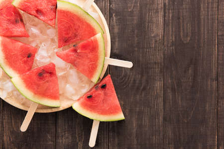 water texture: Fruit ice cream sliced watermelon on wooden background.