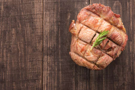 cooked: Top view grilled beef steak on a wooden background. Stock Photo