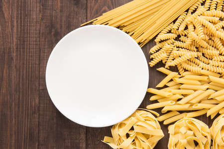 pasta: Mixed dried pasta selection on wooden background, copy space, top view