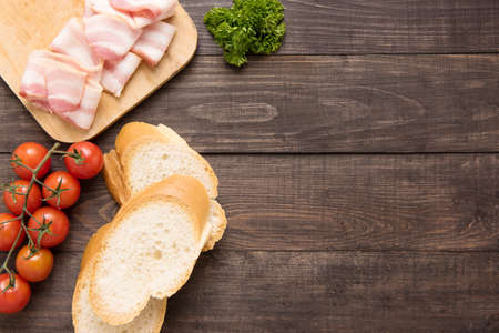 pain: Ingredients for sandwich on wooden background.