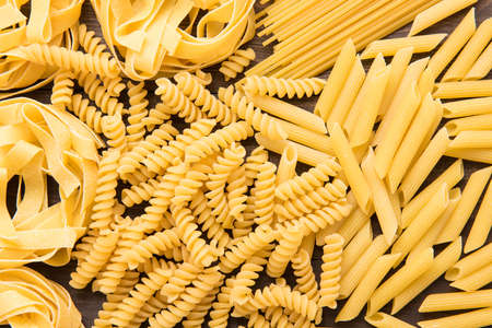 Mixed dried italian pasta collection. Dry pasta background. Stock Photo