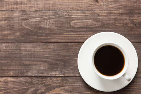 cup of coffee: Coffee cup on wooden background. Top view. Stock Photo