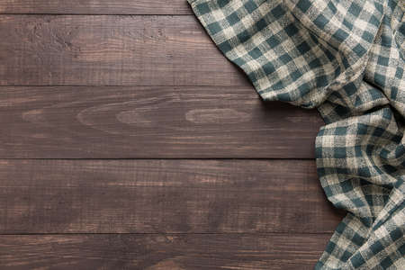 picnic cloth: Napkin on the wooden background. Top view.