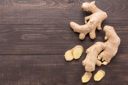 spicy plant: Ginger root on the wooden background. Top view.