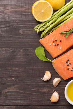 garlic: Fresh salmon fillet with spice on wooden background.