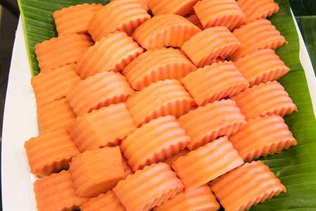 fresh leaf: Fresh slices of ripe papaya on green banana leaf. Stock Photo