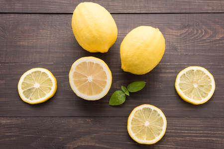 Fresh slice lemon on the wooden background. Stock Photo