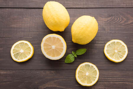 lemon slice: Fresh slice lemon on the wooden background. Stock Photo