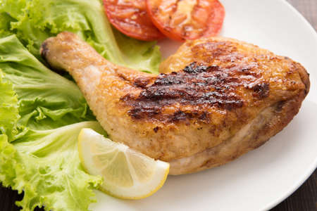 food healthy: Grilled chicken lag and vegetable on white dish.