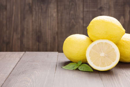 lemon slice: Fresh slice lemon on the wooden table.