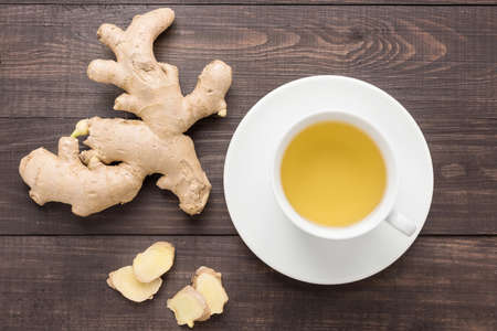 ginger health: Ginger tea and ginger on the wooden background. Stock Photo
