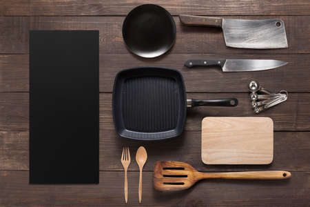 Various kitchenware utensils on the wooden background. Фото со стока - 55643292