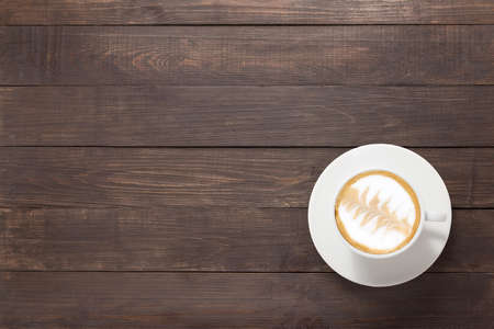 Coffee cup on wooden background. Top view. Banco de Imagens