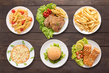 french fries plate: Various food set on the wooden background.