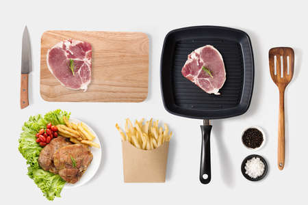 fried food: Concept of mockup bbq steak and french fries set isolated on white background. Stock Photo