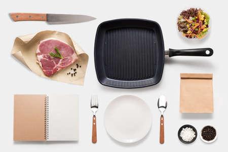 bbq background: Design concept of mockup bbq steak set isolated on white background. Stock Photo