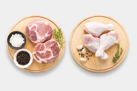 Design of mockup raw chicken and pork on cutting board set set isolated on white background. Clipping Path included on white background.