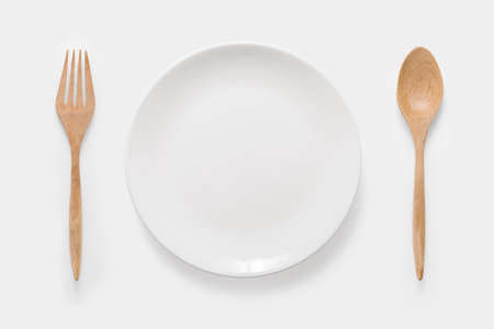 ustensiles de cuisine: Design concept of mockup white dish, wood spoon and wood fork set on white background. Copy space for text and logo. Clipping Path included on white background. Banque d'images