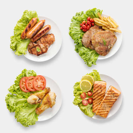 Design of mockup BBQ grilled sausages, chicken, salmon, pork chop, beef set isolated on white background. Clipping Path included on white background. Stock Photo