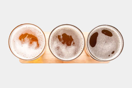 Assortment of beer glasses isolated on white background. Top view. Clipping Path included isolated on white background.