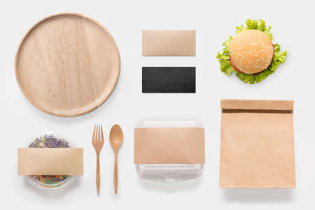 food package: Design concept of mockup burger and salad set isolated on white background. Copy space for text and logo. Clipping Path included isolated on white background. Stock Photo
