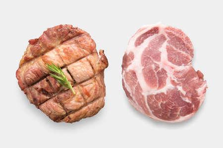 Mockup raw pork chop steak and grilled pork chop steak set isolated on white background. Clipping Path included isolated on white background. Stock Photo