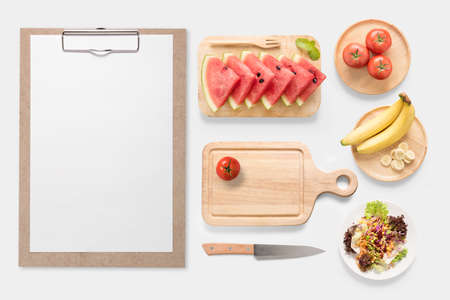 clip board: Design concept of mockup fresh vegetable, fruits and clip board set isolated on white background. Copy space for text and logo. Stock Photo