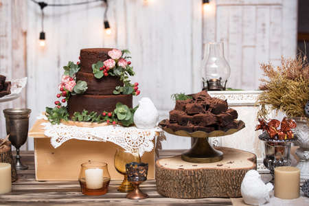 chocolate brownies in stacked on wooden table.