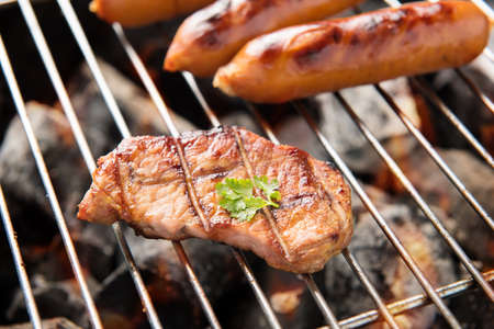 BBQ sausages and meat on the grill Banco de Imagens
