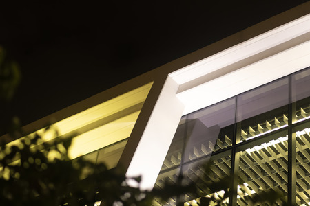 Upview Shot Of Inside A Glass Modern Office Building At Night