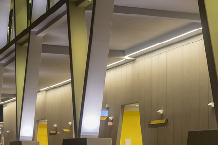 Beautiful Modern Abstract Lit Building At Night With Yellow and White Brand Imagens