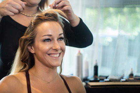 Young Beautiful Smiling Woman Getting Hair Curled