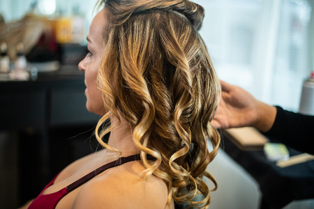 Young Beautiful Female Getting Hair Curled