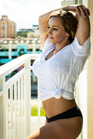 Pretty Woman Stretching On Her Balcony