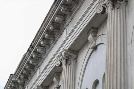 Classic Facade Column Building Roof Angled View From The Street