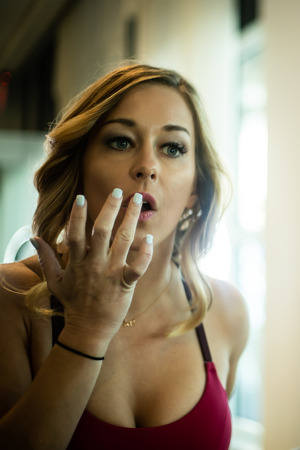 Sexy Woman Applying Makeup In The Mirror In Her Luxurious Bathroom