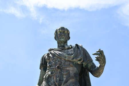 Detail of the bronze statue of the Roman emperor Julius Caesar in Via Dei Fori Imperiali in the center of Rome.
